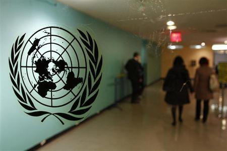 The United Nations logo is displayed on a door at U.N. headquarters in New York February 26, 2011. REUTERS/ Joshua Lott