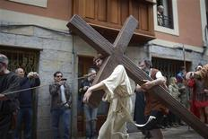Resident Mikel Goikoetxea, playing the role of Jesus Christ, takes part in an Easter Passion Play on Good Friday in the Basque town of Balmaseda March 29, 2013. REUTERS/Vincent West