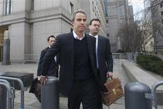 Michael Steinberg (C) leaves Manhattan Federal Court in New York March 29, 2013. REUTERS/Keith Bedford