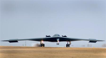 One of three Air Force Global Strike Command B-2 Spirit bombers returns to home base at Whiteman Air Force Base in Missouri, March 20, 2011 after striking targets in support of the international response which is enforcing a no-fly zone over Libya. REUTERS/Kenny Holston/U.S. Air Force photo/Handout