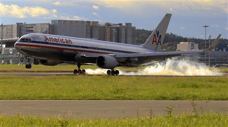 A Boeing B 767-323ER jet of American Airlines lands at the airport in Zurich July 14, 2012. REUTERS/Arnd Wiegmann