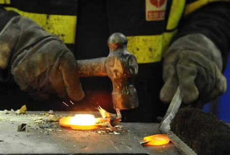 A steel sample is taken by a worker at the SSI steel plant at Redcar, northern England May 29, 2012. REUTERS/Nigel Roddis