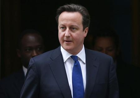 Britain's Prime Minister David Cameron leaves number 10 Downing Street, in central London March 20, 2013. REUTERS/Andrew Winning