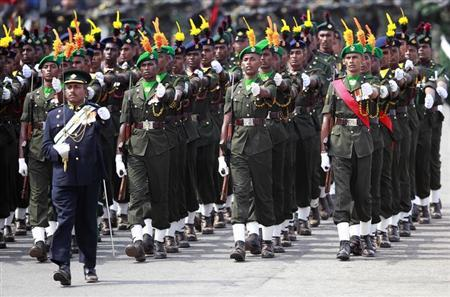 Sri Lankan army soldiers march during a War Victory parade in Colombo May 19, 2012. REUTERS/Dinuka Liyanawatte/Files