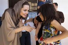 UNHCR Special Envoy Angelina Jolie meets Syrian refugees in the Bekaa Valley, Lebanon in September in this UNHCR handout photo. REUTERS/UNHCR/Jason Tanner/Handout