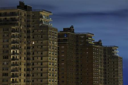 A single room is illuminated in a block of high-rise apartment buildings in the Brighton Beach neighborhood of New York, November 2, 2012. REUTERS/Lucas Jackson