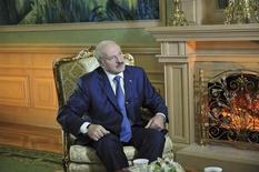 Belarussian President Alexander Lukashenko sits during an interview with Reuters in Minsk November 26, 2012. REUTERS/Yuri Oreshkin/Presidential press service/Handout