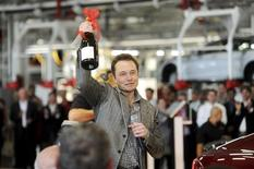 Tesla Chief Executive Officer Elon Musk celebrates at his company's factory as the car company began delivering its Model S electric sedan in Fremont, California, in this June 22, 2012, file photo. REUTERS/Noah Berger/Files