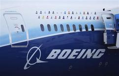 Logos of some Boeing 787 commercial airline clients are seen on a fuselage of the aircraft at the Singapore Airshow in Singapore February 14, 2012. REUTERS/Kevin Lam