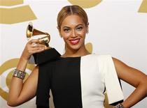 """Beyonce poses with her award for Best Traditional R&B Performance for """"Love On Top"""" backstage at the 55th annual Grammy Awards in Los Angeles, California February 10, 2013. REUTERS/Mario Anzuoni"""