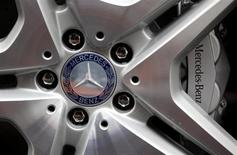 The company's logo is seen on the wheel of a Mercedes S-class limousine during a photo opportunity at the plant of German car manufacturer Mercedes Benz in Sindelfingen near Stuttgart January 30, 2012. REUTERS/Kai Pfaffenbach