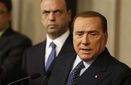 Italy's former Prime Minister Silvio Berlusconi speaks with reporters after a meeting with Italian President Giorgio Napolitano at Quirinale palace in Rome March 29, 2013. REUTERS/Stefano Rellandini