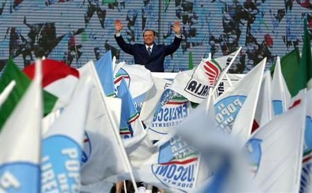 Italy's former Prime Minister Silvio Berlusconi waves during a meeting in Rome March 23, 2013. REUTERS/Yara Nardi