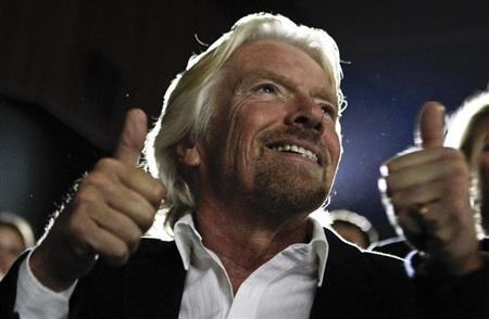 Entrepreneur Richard Branson gestures during a lecture at the Skolkovo School of Management outside Moscow October 23, 2012. REUTERS/Maxim Shemetov/Files
