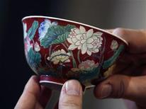 "A magnificent Ruby-Ground Falangcai ""Double-Lotus"" Bowl Blue Enamel Yuzhi Mark and Period of Kangxi is shown after Hong Kong Chinese ceramics dealer William Chak has bought it for HK$74 million ($9.5 million) at Sotheby's Spring Sales in Hong Kong April 8, 2013. REUTERS/Bobby Yip"