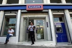 A man comes out of an Eurobank branch in central Athens October 5, 2012. REUTERS/John Kolesidis