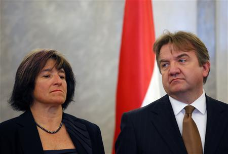 Vice governors of the National Bank of Hungary Julia Kiraly (L) and Ferenc Karvalits listen during the swearing-in ceremony of newly minted NBH Governor Gyorgy Matolcsy at the presidential palace in Budapest in this March 6, 2013 file picture. REUTERS/Laszlo Balogh/Files