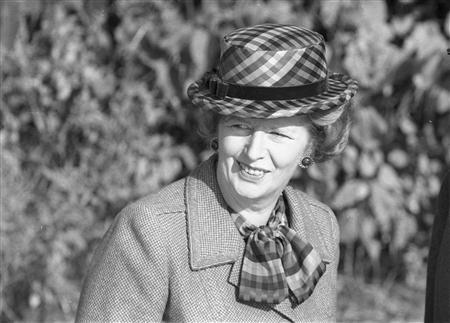 Then Britain's Prime Minister Margaret Thatcher wears a checkered green hat on her 60th birthday as she attends church near her official country residence, Chequers, near Aylesbury, England in this October 13, 1985 file photo. REUTERS/Brian Smith/Files