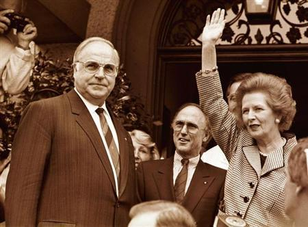 UNDATED FILE PHOTO - Former British Prime Minister Margaret Thatcher waves to well wishers as German Chancellor Helmut Kohl (L) looks on during Thatcher's visit to Germany. Early exit polls indicate that Kohl, the West's longest serving leader, has been defeated by Social Democratic Party challenger Gerhard Schroeder in Germany's general elections September 27.REUTERS