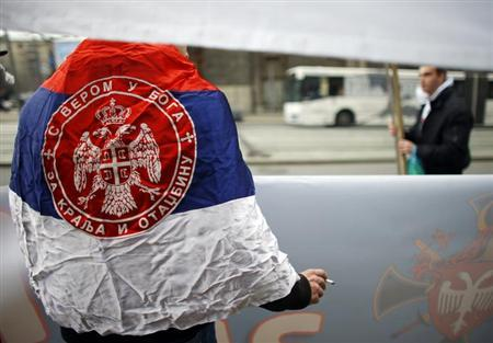 A man wearing Serbian flag attends an anti-European Union protest in Belgrade April 8, 2013. REUTERS/Marko Djurica