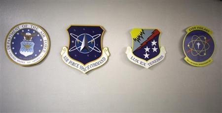 Medallions for (L-R) the U.S. Air Force, Air Force Space Command, Air Force Cyber Command and he Air Force Space Command Network Operations & Security Center (NOSC) are seen outside the NOSC at Peterson Air Force Base in Colorado Springs, Colorado July 20, 2010. REUTERS/Rick Wilking
