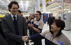 Fiat Chairman John Elkann shakes the hands of employees during the Maserati new opening plant in Turin, January 30, 2013. REUTERS/Stefano Rellandini