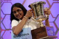 Snigdha Nandipati, 14, of San Diego, California, holds her trophy after winning the Scripps National Spelling Bee at National Harbor in Maryland in this file photo taken May 31, 2012. REUTERS/Kevin Lamarque/Files