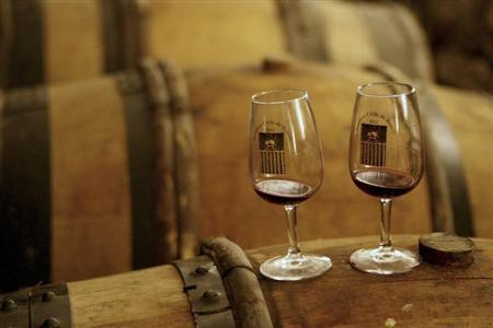 Glasses are seen on a cask during wine tasting in the cellar of Hotel Dieu before the 152nd Hospices de Beaune 2012 Burgundy Wine Auction in Beaune November 18, 2012. REUTERS/Emmanuel Foudrot