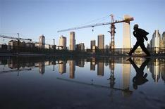 La croissance économique devrait rebondir dans la plupart des grandes économies mondiales, selon les indicateurs avancés de l'OCDE publiés mercredi. Ils signalent entre autres une perspective plus positive en Chine et un rebond dans la zone euro. Pour la France, le mouvement de dégradation serait stoppé. /Photo prise le 6 avril 2013/REUTERS/China Daily
