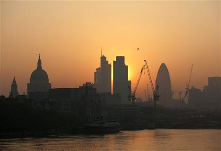 The sun rises above the financial district of the City of London in this April 23, 2011 file photo. REUTERS/Kieran Doherty/Files (BRITAIN - Tags: CITYSCAPE ENVIRONMENT BUSINESS)