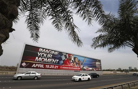 Vehicles travel past a large Bahrain Formula One advertising billboard on main highway leading to Bahrain Internaitonal Circuit, in Manama April 9, 2013. REUTERS/Hamad I Mohammed