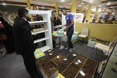 A passerby visits a booth for a Libyan company selling local dates at the Tripoli International Fair, April 8, 2013. REUTERS/Ismail Zitouny