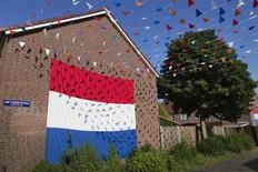 A giant Netherlands' national flag covers the wall of a house at Jan Tooropstraat in Helmond May 24, 2012. REUTERS/Michael Kooren