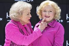 Actress Betty White touches the lips of her wax figure during the unveiling at Madame Tussauds Hollywood wax museum in Los Angeles, California June 4, 2012. REUTERS/Bret Hartman