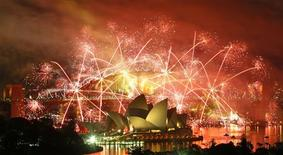 Fireworks explode over the Sydney Harbour Bridge and Opera House during a pyrotechnic show to celebrate the New Year in this January 1, 2009 file photo. REUTERS/Tim Wimborne/Files