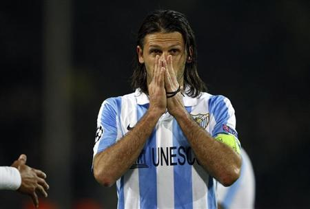 Malaga's captain Martin Demichelis reacts after defeat to Borussia Dortmund in the Champions League quarter-final second leg soccer match, in the western German city of Dortmund April 9, 2013. REUTERS/Wolfgang Rattay