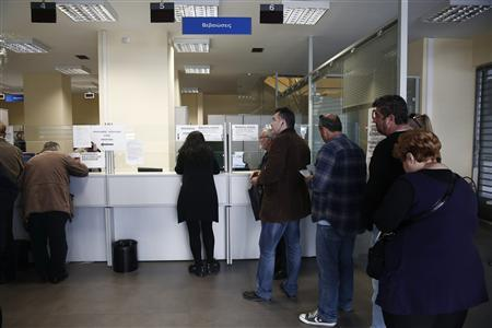 People queue up inside the Greek Manpower Employment Organisation (OAED) in central Athens April 11, 2013. REUTERS/Yorgos Karahalis