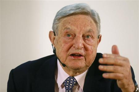 George Soros, Chairman of Soros Fund Management LLC gestures as he addresses the audience during an economic speech in Frankfurt April 9, 2013, on the topic 'How to save the European Union from the euro crisis.' REUTERS/Ralph Orlowski
