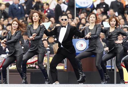 Singer Psy (C) performs during the inauguration of South Korea's President Park Geun-hye (not pictured) at the parliament in Seoul February 25, 2013. REUTERS/Kim Hong-Ji
