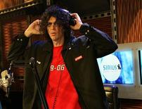 Howard Stern adjusts his headphones before the start of his news conference during the live debut broadcast of his show on Sirius Satellite Radio in New York January 9, 2006. REUTERS/Shannon Stapleton
