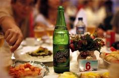 A bottle of beer is seen at a official dinner in Rajin at the Special Economic Zone of Rason City, northeast of Pyongyang August 29, 2011. REUTERS/Carlos Barria