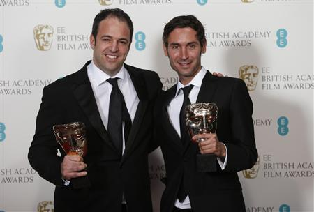 Simon Chinn (L) and Malik Bendjelloul celebrate winning Best Documentary award for ''Searching for Sugar Man'' at the British Academy of Film and Arts (BAFTA) awards ceremony at the Royal Opera House in London in this February 10, 2013 file photograph. REUTERS/Suzanne Plunkett/Files