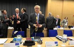 lli Rehn, commissaire européen aux Affaires économiques et monétaires. Les ministres des Finances de la zone euro ont validé vendredi le renflouement de 10 milliards d'euros accordé à Chypre par la troïka des bailleurs de fonds internationaux, composée de la Commission européenne, la Banque centrale européenne (BCE) et le Fonds monétaire international (FMI). /Photo prise le 12 avril 2012/REUTERS/Cathal McNaughton