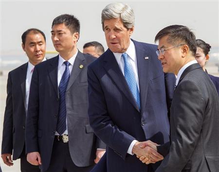 U.S. Secretary of State John Kerry (2nd R) shakes hands with U.S. Ambassador to China Gary Locke (R) upon his arrival at Beijing Capital International Airport April 13, 2013. REUTERS/Paul J. Richards/Pool