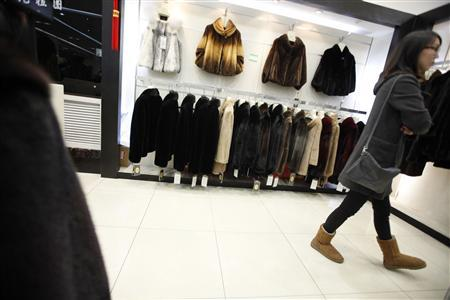 A customer shops at a mink coat store inside a shopping mall in Shanghai, April 4, 2013. REUTERS-Aly Song