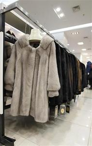 Mink coats are displayed inside a shopping mall in Shanghai, April 4, 2013. REUTERS-Aly Song