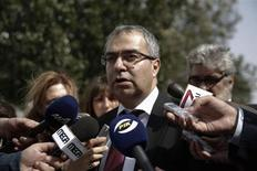 Cyprus Central Bank Governor Panicos Demetriades makes statements outside the parliament in Nicosia March 22, 2013. REUTERS/Yorgos Karahalis