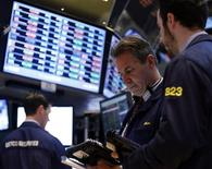Traders work on the floor at the New York Stock Exchange, April 1, 2013. REUTERS/Brendan McDermid