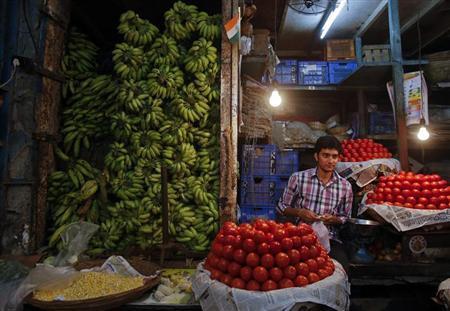 A vendor works at his vegetable stall at a wholesale fruit and vegetable market in Mumbai April 14, 2013. REUTERS/Vivek Prakash