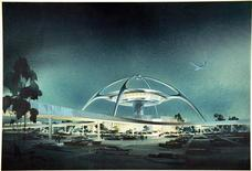 "The iconic Theme Building of Los Angeles International Airport is shown in this 1961 architectural rendering released to Reuters on April 13, 2013. Los Angeles is often seen as a sprawling, smoggy concrete metropolis or a kitschy Hollywood movie set but that image is getting a shiny new makeover in an exhibition that highlights the city's often overlooked contributions to modern architecture. ""Overdrive: L.A. Constructs the Future, 1940-1990,"" takes stock of the city's booming post-World War Two growth, shining a light on buildings that often go unnoticed by the 18 million people living in a metropolitan area about the size of Belgium. REUTERS/Image courtesy of and © The Luckman Partnership, Inc. 